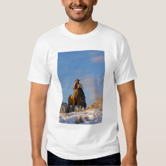 Cowboy on his Horse in the Snow T-shirts