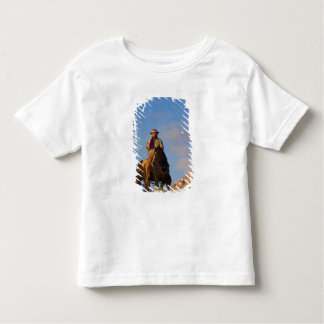 Cowboy on his Horse in the Snow Tees