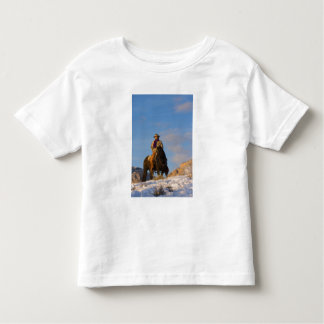 Cowboy on his Horse in the Snow Tshirts