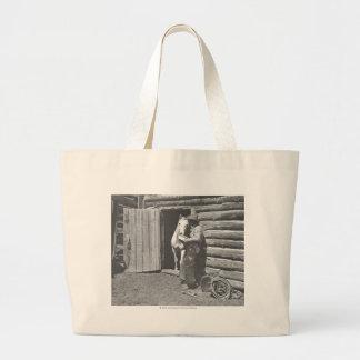 Cowboy reading a letter bag
