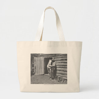 Cowboy reading a letter. large tote bag