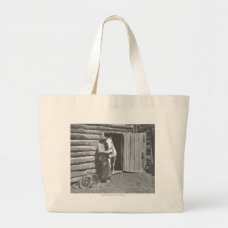 Cowboy reading a letter tote bags