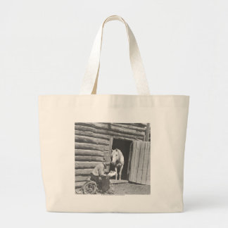 Cowboy reading a letter with a horse large tote bag