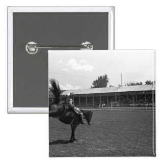 Cowboy riding horse in rodeo, (B&W) 15 Cm Square Badge