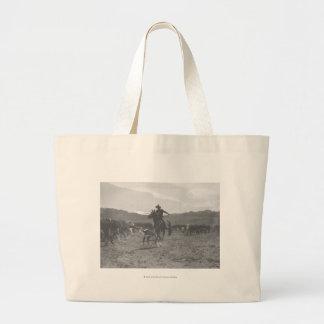 Cowboy roping a calf for spring branding. jumbo tote bag