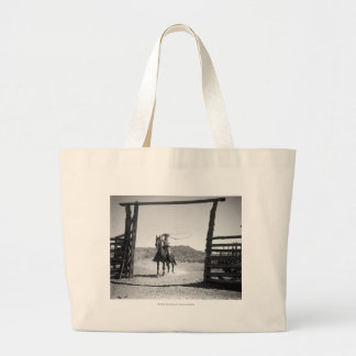Cowboy roping large tote bag
