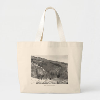 Cowboy separated from his herd. large tote bag