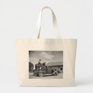 Cowboy with horse in a truck large tote bag