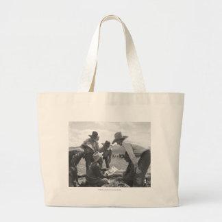 Cowboys looking a magazine jumbo tote bag