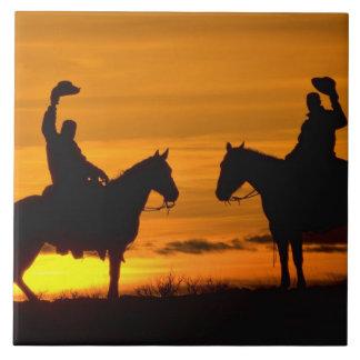 Cowboys on ridge at Sunset Ceramic Tile