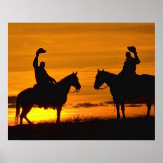 Cowboys on ridge at Sunset Poster