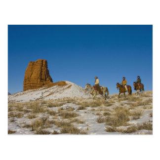 Cowboys on Ridge riding Horse through the Snow Postcard