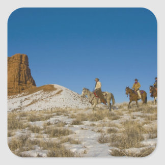 Cowboys on Ridge riding Horse through the Snow Square Sticker