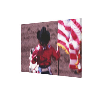Cowgirl Carrying the American Flag at the Rodeo Canvas Print