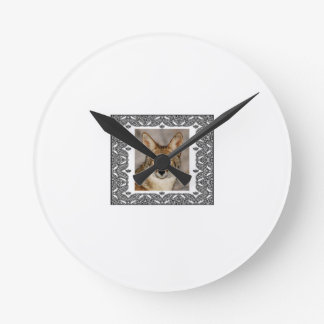 coyote in a frame round clock