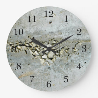 Cracked concrete wall with small stones large clock