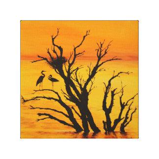 Crane under the Sunset Canvas Print