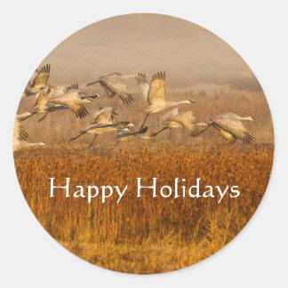 Cranes over golden field, Happy Holidays Classic Round Sticker