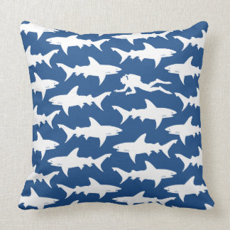 Crazy Diver Swimming in Middle of School of Sharks Throw Pillow