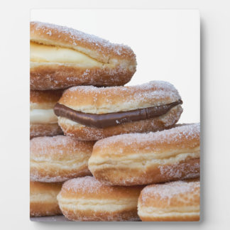 cream and chocolate donuts plaque