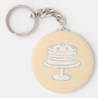 Cream Color Cake on Beige Background. Key Chain