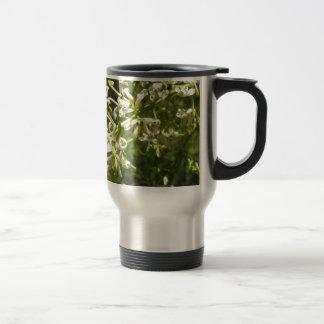Cream on green stainless steel travel mug
