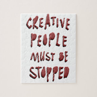 CREATIVE PEOPLE MUST BE STOPPED JIGSAW PUZZLE