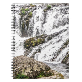 creeks pours over rocks notebook