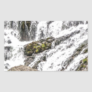 creeks pours over rocks rectangular sticker