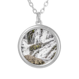 creeks pours over rocks silver plated necklace