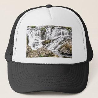 creeks pours over rocks trucker hat