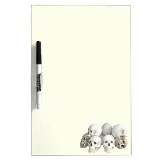Creepy skulls pile dry erase board