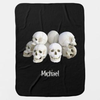 Creepy skulls pile name baby receiving blanket