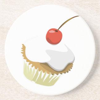 Creme cupcake with cherry coaster