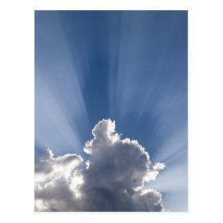 Crepuscular or God's rays streak past cloud. Postcard