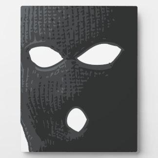 criminal-mask plaque
