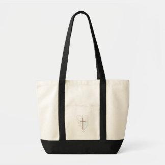 cross and wings tote bag