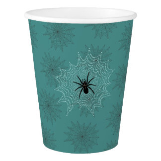 Cross spider in the net with rope drops such as paper cup