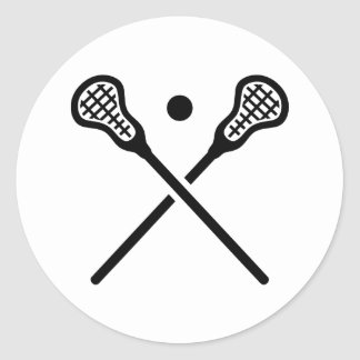 Crossed lacrosse sticks ball classic round sticker