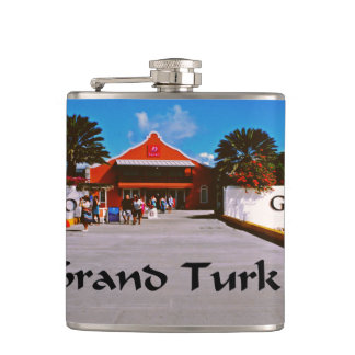 Cruise ship docked at a tropical exotic island hip flask