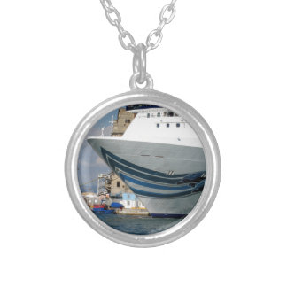Cruise ship moored in a harbor silver plated necklace