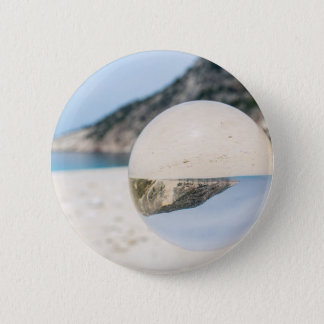 Crystal ball on sandy greek beach 6 cm round badge