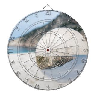 Crystal ball on sandy greek beach dartboard