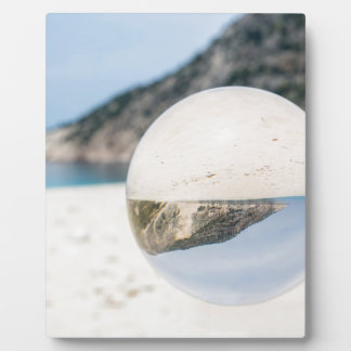 Crystal ball on sandy greek beach plaque