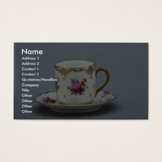 Cup and saucer with colorful flowers on it. business card