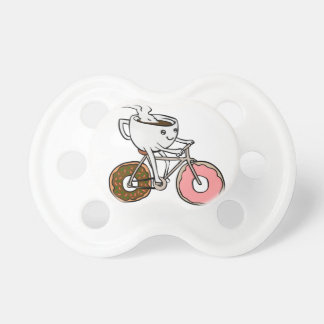 Cup riding a bicycle with donut wheels dummy