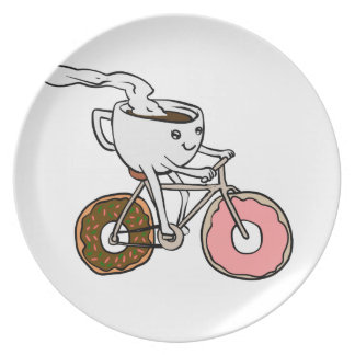 Cup riding a bicycle with donut wheels plate