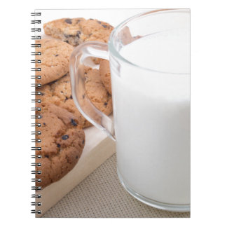 Cup with milk and oatmeal cookies notebook