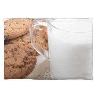 Cup with milk and oatmeal cookies placemat