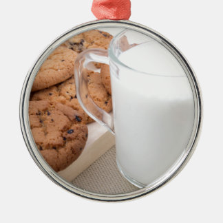 Cup with milk and oatmeal cookies Silver-Colored round decoration